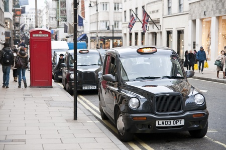 LONDON - FEBRUARY 04: Traditional black cabs parked in New Bond Street, one of the most expensive areas in London, home to fine art galleries and auction houses such as Sothebys. February 04, 2011 in London, England.