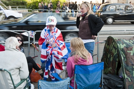 royal wedding: LONDON - APRIL 27: Royal family fans camp to secure a good spot at Westminster Abbey for Prince William and Catherine Middletons royal wedding celebration to take place April 29. April 27, 2011 in London, England. Editorial