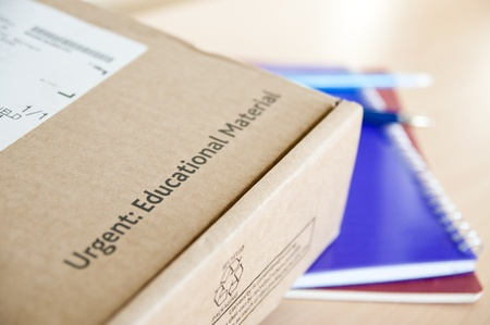 High angle shot of distance learning cardboard box with notebooks underneath. Stock Photo - 11872643