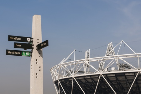 LONDON, UK – MARCH 24: Details of sign post with Olympic stadium in the background on March 24, 2012 in London. All locations around the Olympic Park are undergoing redevelopment works. Editorial