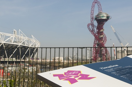 LONDON, UK – MARCH 24: Details of information board with London Olympics logo and Stadium and sculpture in the background on March 24, 2012 in London. The Olympic Park is due to be ready in summer.