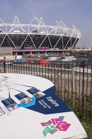 LONDON, UK – MARCH 24: Details of information board with London Olympics logo and Olympic Stadium in the background on March 24, 2012 in London. The Olympic Park is due to be ready in summer for the games.