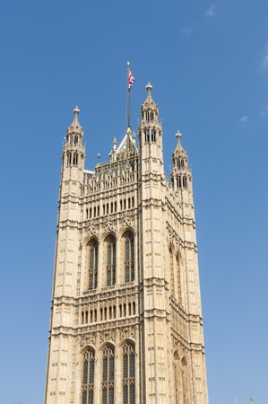 One of the towers of Houses of Parliament in London, UK, with British Union flag atop. Stock Photo - 13095561
