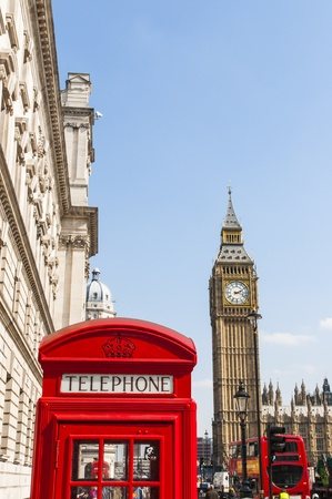 London famous red phone booth, with Big Ben in the background.