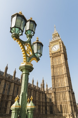 Low angle shot of Big Ben in London, with ornamented lamppost in the foreground. Stock Photo - 13095560