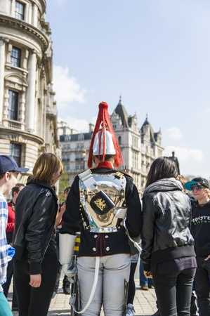 LONDON, UK - APRIL 02: One of the Royal Horse Guards from behind, in typical outfit. April 02, 2012 in London. Stock Photo - 13062855