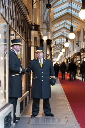 LONDON, UK - JANUARY 13: Traditional doormen in front of Burlington Arcade. January 13, 2012 in London. Plans to replace the mall's floor were thrown out after a legal battle, but renewal works have started despite opposition by shop owners. Editorial