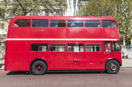 Side view of London red double deck bus.