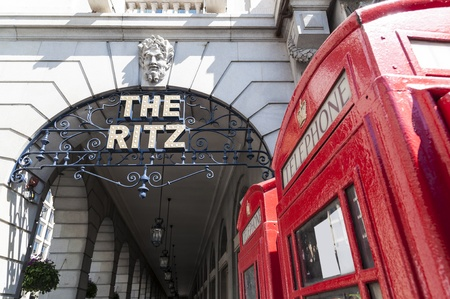 LONDON, UK - APRIL 30: Details of the Ritz hotel entrance, with red phone booth. April 30, 2012 in London. The luxury hotel dates back from 1905. Stock Photo - 13460521