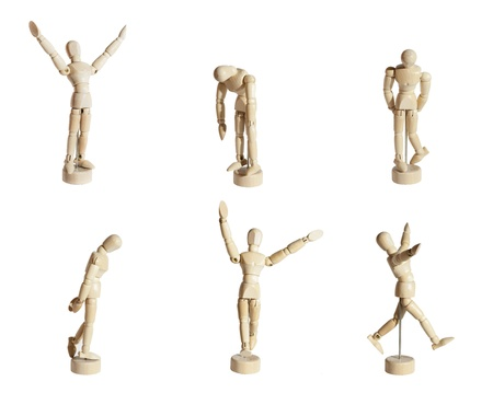 Six wood mannequins showing diverse emotions against white background. Stock Photo