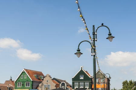 volendam: Detail of lamp post in Volendam, Holland, with traditional Dutch houses in the background Stock Photo