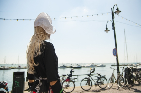 Female mannequin dressed in traditional dutch outfit with blurred coastal background  Stock Photo