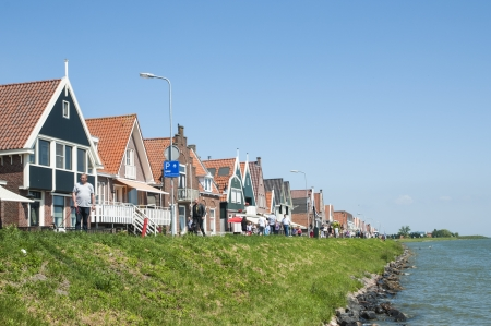volendam: VOLENDAM, HOLLAND - MAY 28: Main street that connects Volendam to the village of Edam. May 28, 2012 in Volendam.