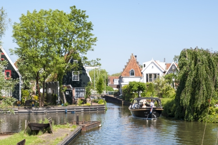 EDAM, HOLLAND - MAY 28: Detail of one of the canal that cross the city, with private boat. May 28, 2012 in Edam.