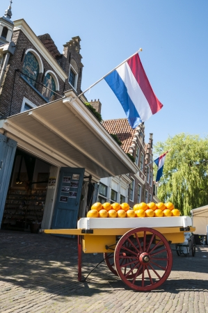 EDAM, HOLLAND - MAY 28: The famous cheese market of Edam, with loaded cheese cart. May 28, 2012 in Edam.