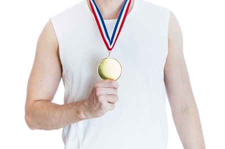 Cropped torso of man holding blank sports gold medal.