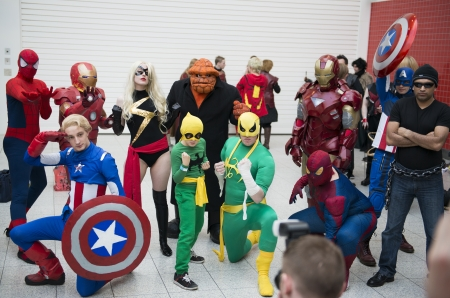 LONDON, UK - OCTOBER 27: Cosplayers impersonating Marvel superheroes pose for photographers at the London Comicon MCM Expo. Most participants dress up in superhero costumes to compete in the Euro Cosplay Championship. October 27, 2012 in London. Editorial