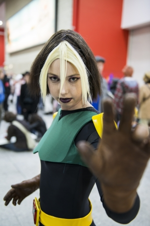LONDON, UK - OCTOBER 27: Cosplayer impersonating super heroine Rogue poses for photographers at the London Comicon MCM Expo. Most participants dress up in superhero costumes to compete in the Euro Cosplay Championship. October 27, 2012 in London.