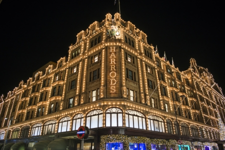 LONDON, UK - NOVEMBER 05: Corner of famous department store Harrods. Its Christmas lights have become a London tradition. November 05, 2012 in London.