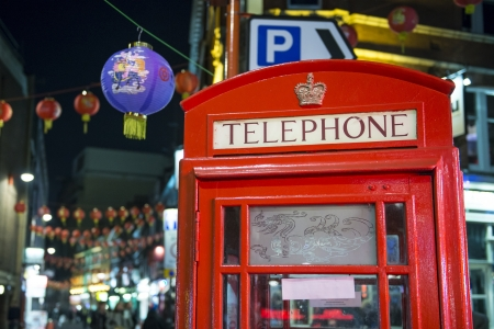 LONDON, UK - NOVEMBER 05: Detail of traditional red phone booth in Chinatown, the main Chinese commercial district in the city. November 05, 2012 in London. Stock Photo - 16225106