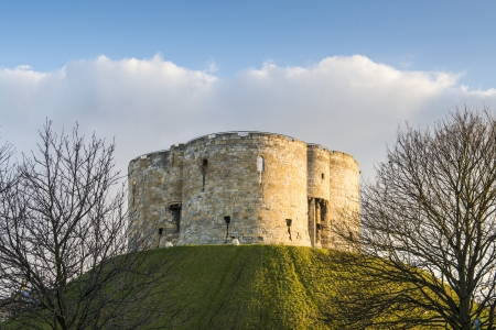 North face of Clifford's Tower, in York, UK. The tower is part of the York castle.