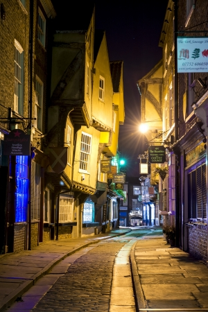 shambles: YORK, UK - MARCH 30: The Shambles is a former butchers street in York with some buildings dating back from the fourteenth century . March 30, 2013 in York.