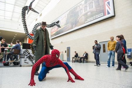 spiderman: LONDON, UK - May 26: Spiderman and Doctor Octopus cosplayers posing at the MCMExpo at the Excel Centre. May 26, 2013 in London.