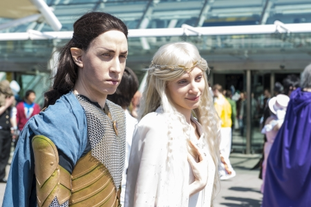 excel: LONDON, UK - May 26: Lord of the Rings Elrond and Galadriel cosplayers outside the Excel Centre at the MCMExpo. May 26, 2013 in London.