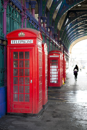 Old red telephone booth in Smithfield meat market in London, UK photo
