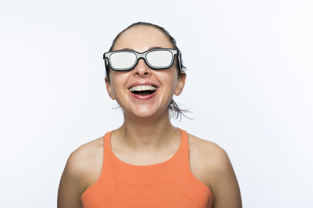 Portrait of beautiful caucasian woman wearing large 3D cinema glasses and smiling photo