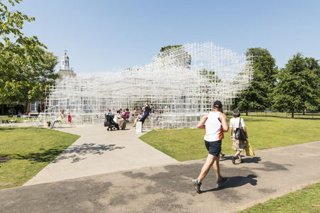 sou: LONDON, UK - AUGUST 01: Park visitors enjoying the sunny weather at the Serpentine gallerys pavilion designed by architect Sou Fujimoto in Kensington Gardens. August 01, 2013 in London. Editorial