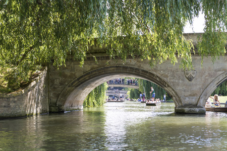 punter: CAMBRIDGE, UK - AUGUST 18: Details of the oldest bridge in Cambridge, Claire Bridge, and busy River Cam full of tourist punter in gondolas in the background. August 18, 2013 in Cambridge. Editorial