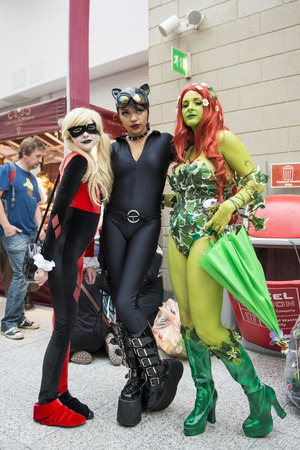 LONDON, UK - OCTOBER 26: Cosplayers dressed as a  Harley Quinn, Catwoman and Poison Ivy from Batman for the Comicon at the Excel Centre's MCM Expo. October 26, 2013 in London.
