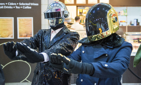 comic duo: LONDON, UK - OCTOBER 26: Cosplayers dressed as the musical duo from Daftpunk in the Comicon at the Excel Centres MCM Expo. October 26, 2013 in London.