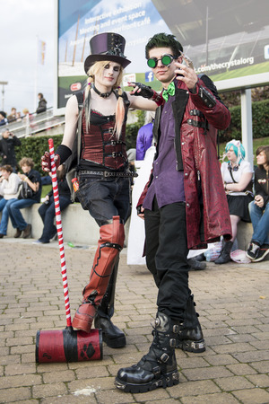 LONDON, UK - OCTOBER 26: Cosplayers dressed as a steampunk version of Harley Quinn and the Joker from Batman for the Comicon at the Excel Centres MCM Expo. October 26, 2013 in London.