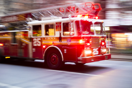 NEW YORK, US - NOVEMBER 21: Motion blurred shot of famous New York fire engine with lights flashing. November 21, 2013 in New York.