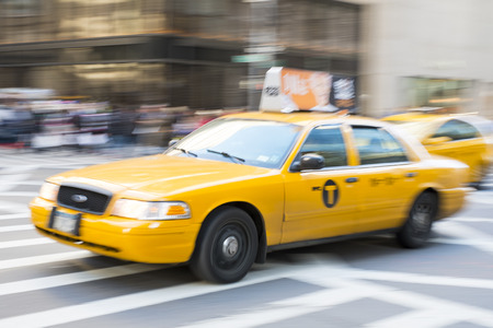 NEW YORK, US - NOVEMBER 23: Motion blurred shot of famous New York yellow taxi. November 23, 2013 in New York.
