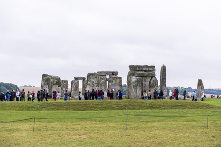 queueing: STONEHENGE, WILTSHIRE, UK - AUGUST 17: Tourists queueing for the ancient archeological site of Stonehenge, which was added to the UNESCO World Heritage Sites in 1986 and dates back from 3100BC. August 17, 2013 in Wiltshire, UK. Editorial