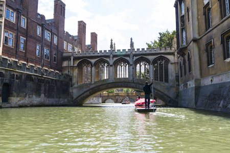 punter: CAMBRIDGE, UK - AUGUST 18: Tourist punter River Cam and the Bridge of Sights, Saint Johns College, in the background. August 18, 2013 in Cambridge.