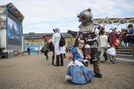 LONDON, UK - OCTOBER 26: Cosplayers dressed as Big Daddy and Little Sister from the Bioshock game from Star Wars for the Comicon at the Excel Centres MCM Expo. October 26, 2013 in London.