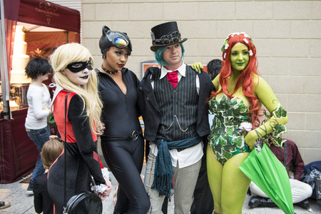 catwoman: LONDON, UK - OCTOBER 26: Cosplayers dressed as a  Harley Quinn, Catwoman and Poison Ivy from Batman for the Comicon at the Excel Centres MCM Expo. October 26, 2013 in London. Editorial