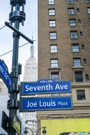 joe louis: NEW YORK, US - NOVEMBER 23: Seventh Avenue and Joe Louis Plaza street signs. November 23, 2013 in New York.