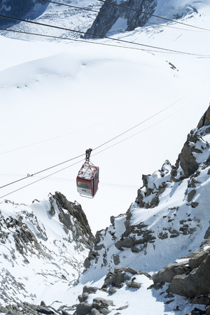 aiguille: CHAMONIX, FRANCE - SEPTEMBER 02: Aiguille du Midi cable car. The cable car is the highest in Europe, and offers close views of the Mont Blanc summit. September 02, 2014 in Chamonix.