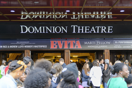 evita: LONDON, UK - OCTOBER 05: Visitors at the entrance to the musical Evita, in the Dominon Theatre, The musical replaces We Will Rock You, which ran for 12 years. October 05, 2014 in London.