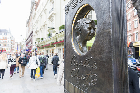 LONDON, UK - OCTOBER 26: Agatha Christie book shaped memorial with busy street in the background. The bronze memorial was unveiled on the 18 November 2012. October 26, 2014 in London. Editorial