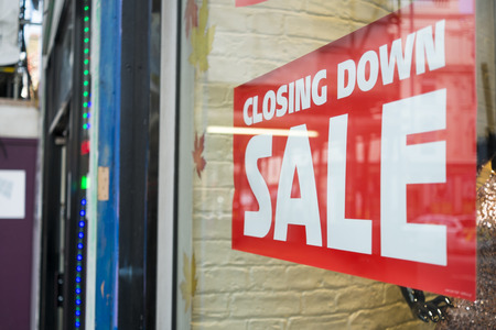 for sale sign: Closing down sale sign on shop window