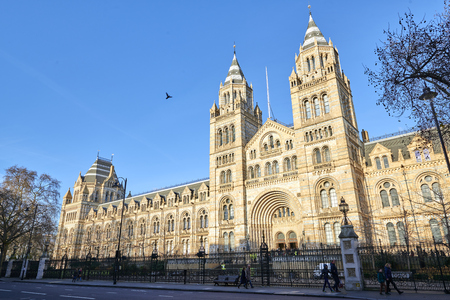LONDON, UK - DECEMBER 20: Facade of the Natural History museum in bright sunny day. December 20, 2014 in London.
