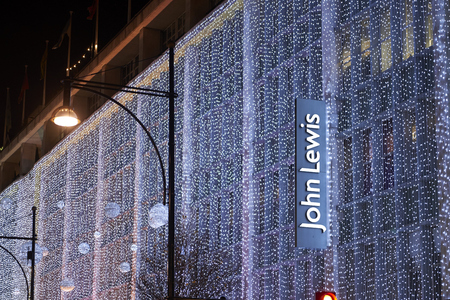 LONDON, UK - DECEMBER 20: Nighttime shot of John Lewis department store with its wall of light as part of its Christmas decoration. December 20, 2014 in London. Editorial
