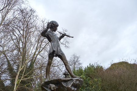 barrie: LONDON, UK - DECEMBER 23: Detail of statue of Peter Pan. December 23, 2014 in London. The sculpture, by Sir George Frampton, was placed in Kensington Gardens in 1912. Editorial