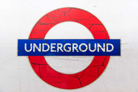 run down: LONDON, UK - London JANUARY 31: Details of run down logo of the London Underground, with paint cracking and peeling off. January 31, 2015 in London. Editorial